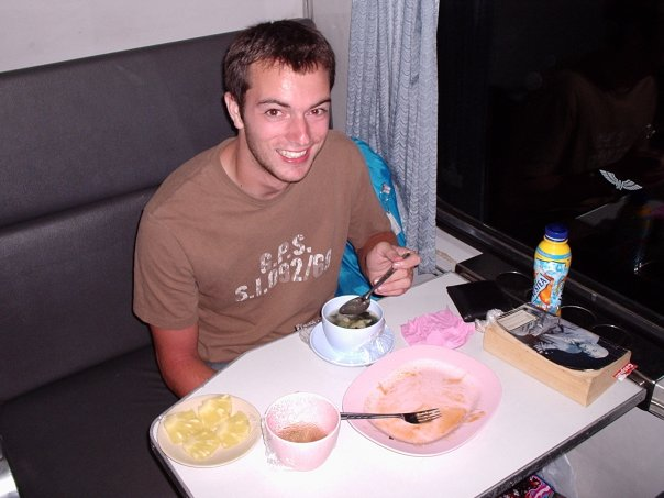 Josh having a random Thai meal on the train before his seat was converted into his bed.