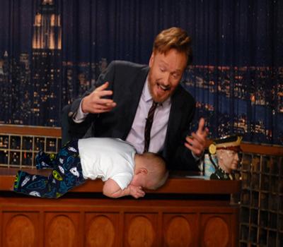 baby planking Conan O'Brien's desk