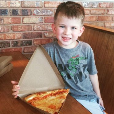 It is most appropriate for the kid to wolf down pizza right before we go see Ninja Turtles 2.